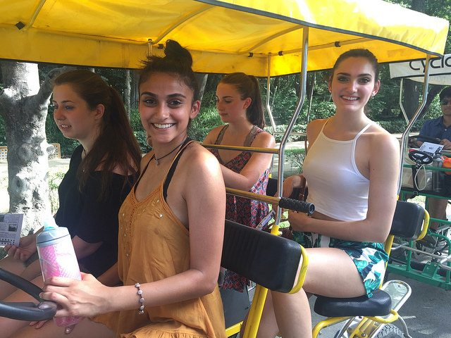 AP Language and Culture program students enjoying a bike ride in Maria Luisa Park.