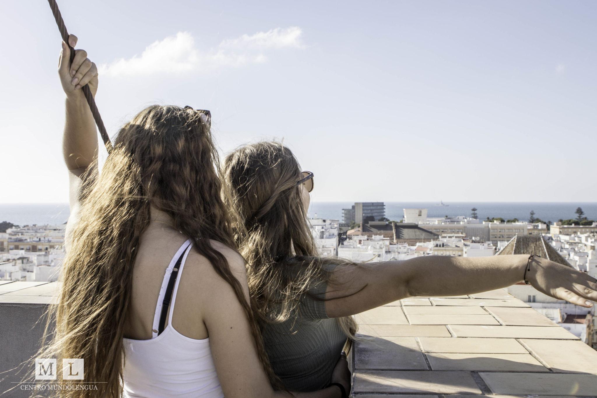 Students doing the 'Titanic' in Cadiz